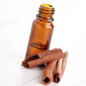 bottle of cinnamon aromatherapy oil - beauty treatment